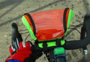 Not the greatest representation of the orange, but this Handlebar Bag is Neon Green and Blaze Orange