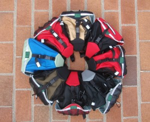 Small Saddlebags in assorted colors: Electric blue and celery, Olive and black, Black and Red, Navy and Gray, Red and Black, Black and Red, Tan and Black, Red and Red.
