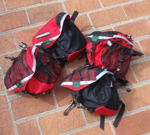 Small Saddlebags in Black and red, red and black, black and red, and red and red