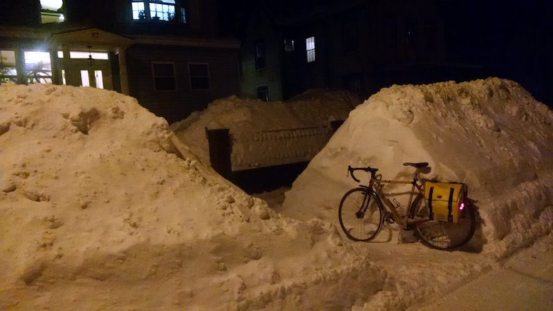 snow piles with bike